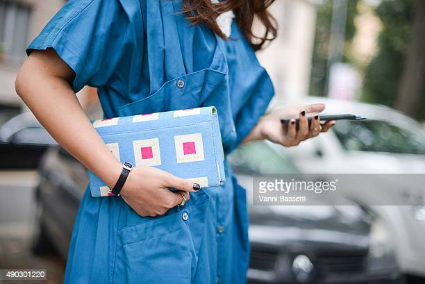 Rebecca Pan poses wearing a vintage dress and a Bulgari bag before the Marni show during the Milan Fashion Week Spring/Summer 16 on September 27 2015...