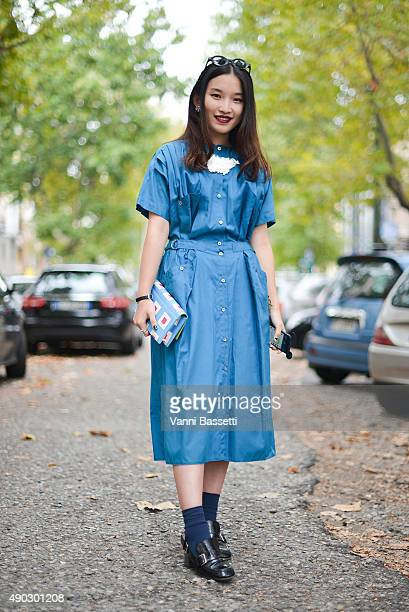 Rebecca Pan poses wearing a vintage dress before the Marni show during the Milan Fashion Week Spring/Summer 16 on September 27 2015 in Milan Italy