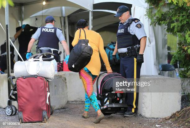 Rebecca Paul and her baby girl crosses from the US to Canada at the border along Roxham Road on Sunday Aug 13 2017