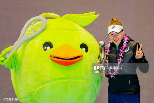 Rebecca Peterson of Sweden poses after winning the women's singles final against Heather Watson of Britain at the Tianjin Open tennis tournament in...