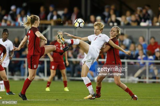 Rebecca Quinn of Canada competes for the ball against Samantha Mewis and Lindsey Horan of the United States during a friendly match at Avaya Stadium...