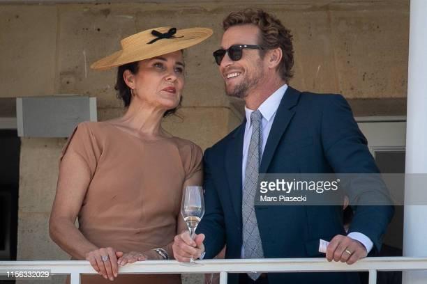 Rebecca Rigg and actor Simon Baker attend the Prix De Diane 2019 at hippodrome de Chantilly on June 16 2019 in Paris France