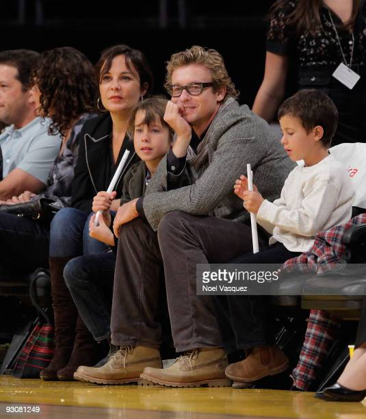 Rebecca Rigg Claude Blue Simon Baker and Harry Friday attend a game between the Houston Rockets and the Los Angeles Lakers at Staples Center on...