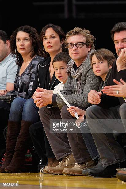 Rebecca Rigg Harry Friday Simon Baker and Claude Blue attend a game between the Houston Rockets and the Los Angeles Lakers at Staples Center on...