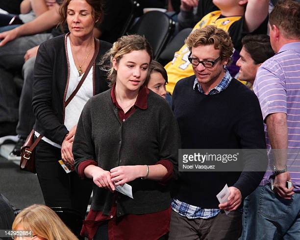 Rebecca Rigg Stella Breeze Claude Blu and Simon Baker attend a basketball game between the Dallas Mavericks and the Los Angeles Lakers at Staples...