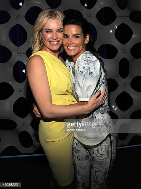 Rebecca Romijn and Angie Harmon attend the TBS / TNT Upfront 2014 at The Theater at Madison Square Garden on May 14 2014 in New York City...