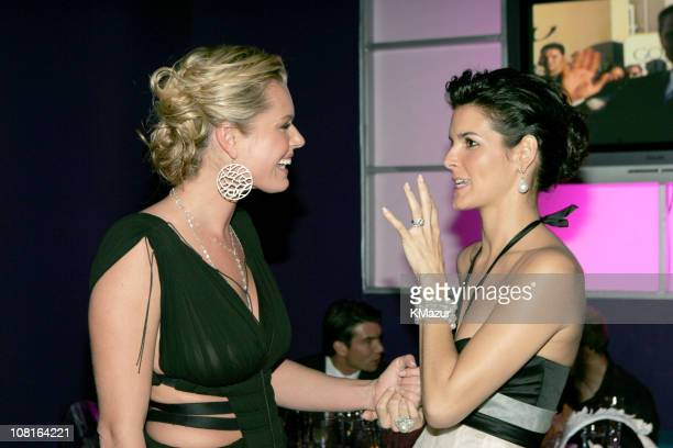 Rebecca Romijn and Angie Harmon during 2005 InStyle/Warner Bros Golden Globes Party Inside at The Palm Court at the Beverly Hilton in Beverly Hills...