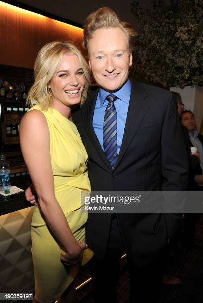 Rebecca Romijn and Conan O'Brien attend the TBS / TNT Upfront 2014 at The Theater at Madison Square Garden on May 14 2014 in New York City...