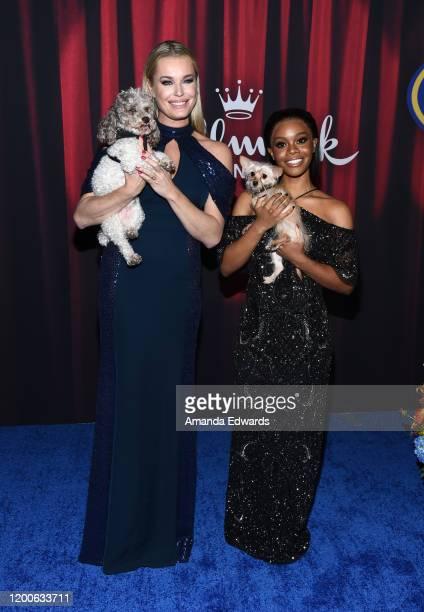 Rebecca Romijn and Gabby Douglas arrive at the 2020 American Rescue Dog Show at Barker Hangar on January 19 2020 in Santa Monica California