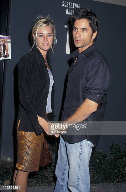 Rebecca Romijn and John Stamos during 1st Annual Hollywood Film Festival Allie And Me Screening at Universal Studios in Los Angeles California United...