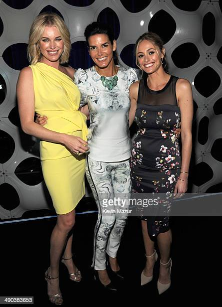 Rebecca Romijn Angie Harmon and Elizabeth Mansucci attend the TBS / TNT Upfront 2014 at The Theater at Madison Square Garden on May 14 2014 in New...