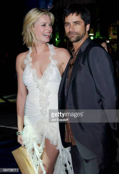Rebecca Romijn Stamos and John Stamos during X2 XMen United Premiere Los Angeles Blue Carpet Arrivals at Grauman's Chinese Theatre in Hollywood...