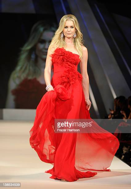 Rebecca Romijn walks on the runway wearing a Marchesa design at The Heart Truth's Red Dress Collection 2012 Fashion Show at Hammerstein Ballroom on...