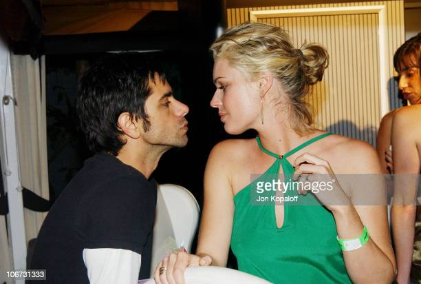Rebecca RomijnStamos and John Stamos during PlayStation 2 'Bungalow Beach Party' at Viceroy Hotel in Santa Monica California United States