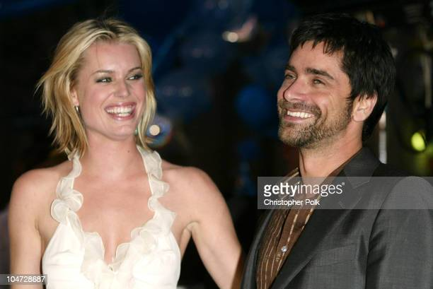 Rebecca RomijnStamos John Stamos during X2 XMen United Premiere Los Angeles Blue Carpet Arrivals at Grauman's Chinese Theatre in Hollywood California...