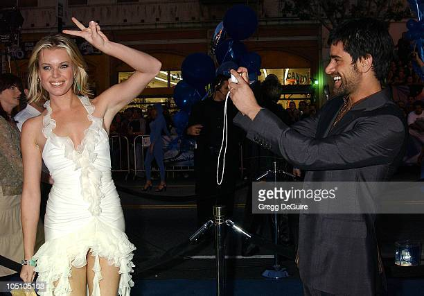 Rebecca RomijnStamos John Stamos during X2 XMen United Premiere Los Angeles Arrivals at Grauman's Chinese Theatre in Hollywood California United...
