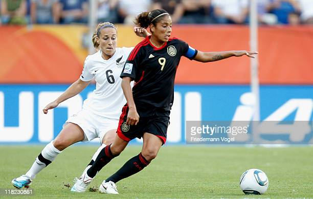 Rebecca Smith of New Zealand and Maribel Dominguez of Mexico battle for the ball during the FIFA Women's World Cup 2011 Group B match between New...