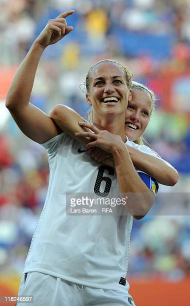 Rebecca Smith of New Zealand who scored his teams first goal celebrates with team mate Katie Hoyle after the FIFA Women's World Cup 2011 Group B...