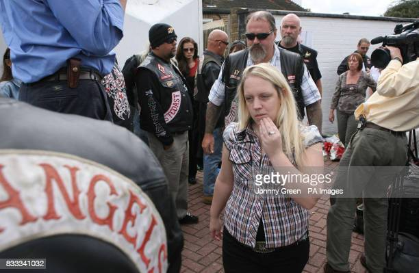 Rebecca Smith the girlfriend of murdered Hell's Angel Gerry Tobin, walks away after facing the media at Warr's Harley-Davidson Motorcycles in...