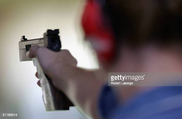 Rebecca Snyder of the USA lines up a shot during the women's 25 metre pistol qualifying event on August 18, 2004 during the Athens 2004 Summer...