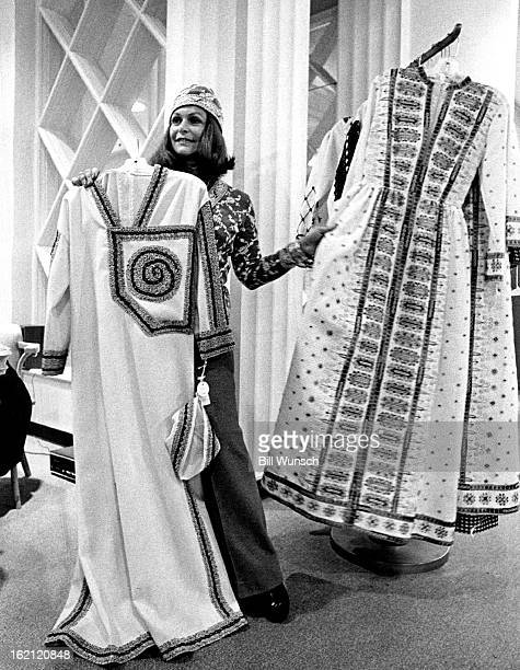NOV 16 1972 Rebecca Welles Displays part of her Spring Collection At left is a white caftan with matching cap At right is long gown