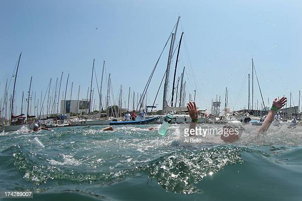 Rebecca Wilke Mann of USA throws away her drink during the Open Water Swimming Women's 10k race on day four of the 15th FINA World Championships at...