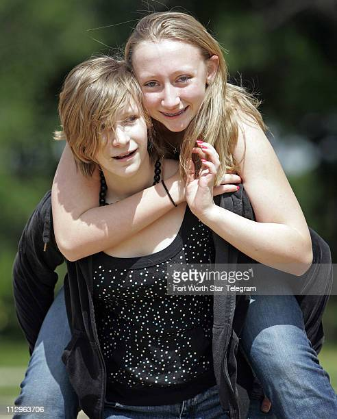Rebecca Wilson gets a piggyback ride from her sister Sarah at Waggoner Park in Grand Prairie Texas Thursday April 5 2007 Rebecca Wilson has diabetes...