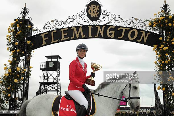 Rebeccah Panozza 2014 fashion on the field ambassador poses with the cup during the official Melbourne Cup Carnival Launch at Flemington Racecourse...