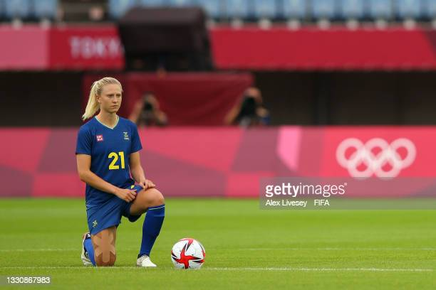 Rebecka Blomqvist of Team Sweden takes a knee in support of the Black Lives Matter movement prior to the Women's Group G match between New Zealand...