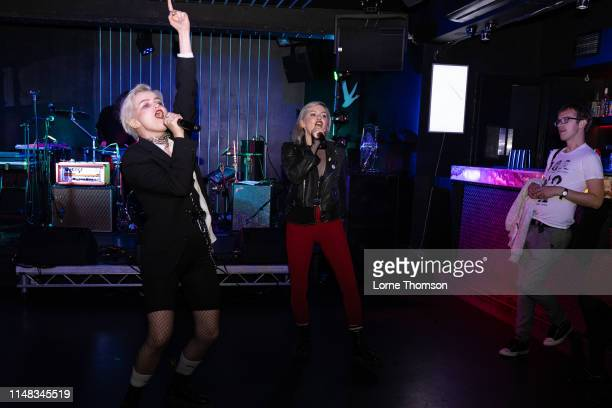 Rebecka Digervall and Sanna Kalla of The Magnettes perform at Door 77 on May 10, 2019 in Brighton, England.