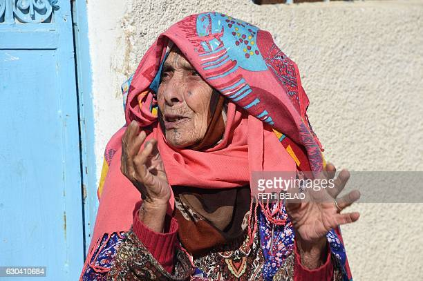 Rebeh a 90yearold woman sits outside her home in the town of Oueslatia in Tunisia's region of Kairouan on December 22 2016 BELAID