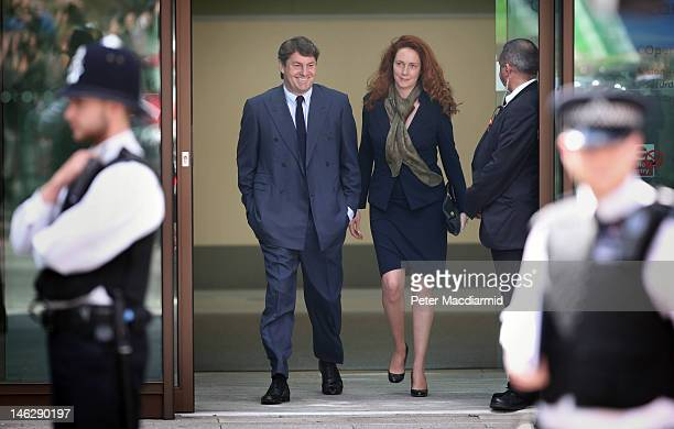 Rebekah Brooks and her husband Charlie Brooks leave Westminster Magistrates Court on June 13, 2012 in London, England. Mrs Brooks, the former News...