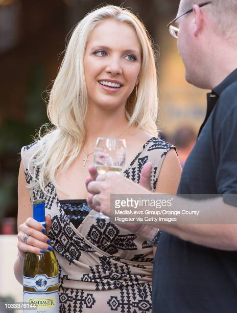 Rebekah Farrar left of Rombauer Vineyards shares information about the wine during the 4th Annual Kaleidoscope Wines and Wishes event in Mission...