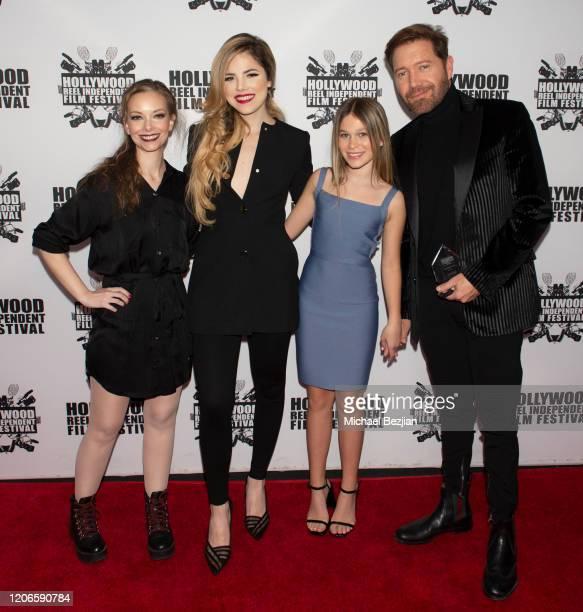 Rebekah Kennedy Maria Gabriela Cardenas Harlow Rocca and Oscar Cardenas arrives at A Dark Foe Film Premiere on February 15 2020 in Los Angeles...