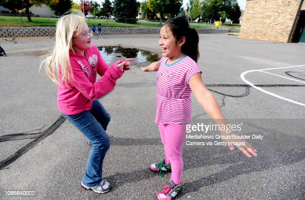 Rebekah Kleder gives a positive body image compliment to free a frozen Jaymee Hawk in an tag game during a Girls on the Run of the Rockies meeting at...