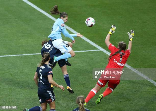 Rebekah Stott of Melbourne City heads the ball past Victory goalkeeper Casey Dumont to score during the round two WLeague match between Melbourne...