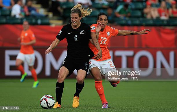 Rebekah Stott of New Zealand and Shanice Van de Sanden of the Netherlands challenge for the ball during the FIFA Women's World Cup 2015 Group A match...