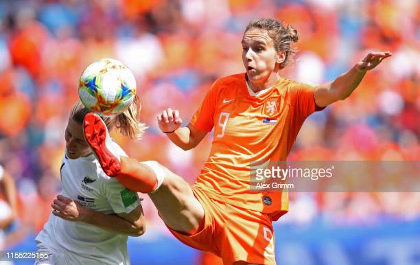 Rebekah Stott of New Zealand battles for possession with Vivianne Miedema of the Netherlands during the 2019 FIFA Women's World Cup France group E...