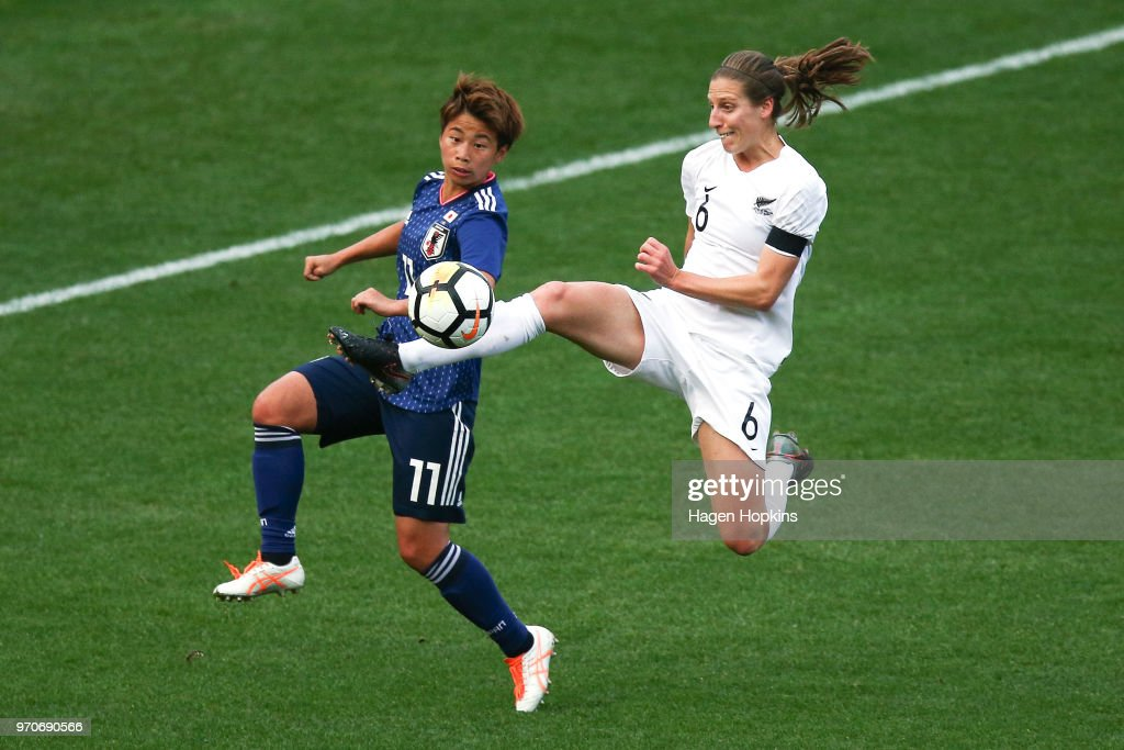 Rebekah Stott of New Zealand controls the ball while Mina Tanaka of Japan looks on during the International Friendly match between the New Zealand Football Ferns and Japan at Westpac Stadium on June 10, 2018 in Wellington, New Zealand.
