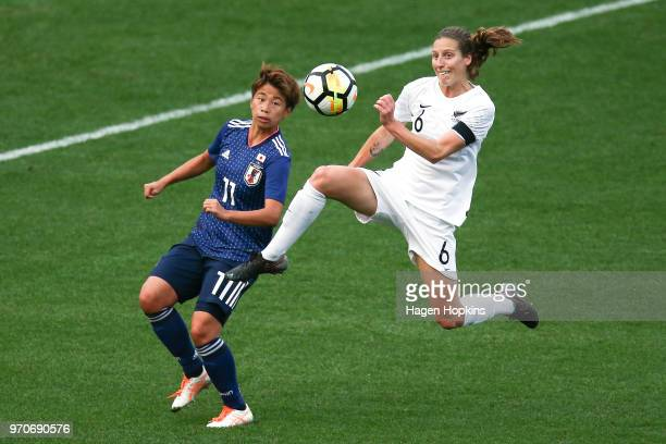 Rebekah Stott of New Zealand controls the ball while Mina Tanaka of Japan looks on during the International Friendly match between the New Zealand...