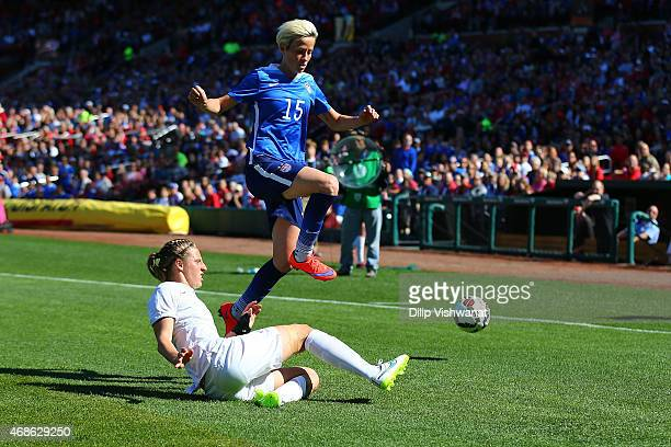 Rebekah Stott of New Zealand kicks the ball away from Megan Rapinoe of the United States at Busch Stadium on April 4 2015 in St Louis Missouri