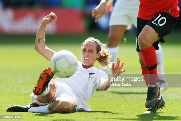 Rebekah Stott of New Zealand kicks the ball away to defend against Lee Geummin of Korea Republic during the Cup of Nations match between the Korea...