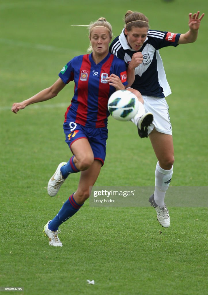 Rebekah Stott of the Melbourne Victory and Tara Andrews of the Newcastle Jets contest the ball during the round 12 W-League match between the Newcastle Jets and the Melbourne Victory at Wanderers Oval on January 13, 2013 in Newcastle, Australia.