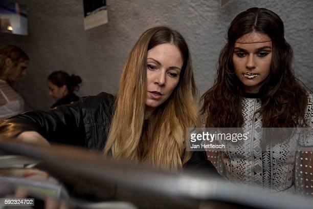 Rebekka Ruetz and a model are seen backstage ahead of the Rebekka Ruetz Fashion Show At 'Kulinarik Kunst Festival' on August 20 2016 in St Anton am...
