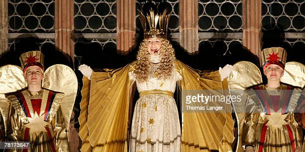 Rebekka Volland dressed as the Christ Child appears in the window of the Frauen Kirche during the opening ceremony of the Christmas Market on...