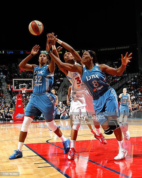 Rebekkah Brunson and Taj McWilliamsFranklin of the Minnesota Lynx battle for a rebound against Angel McCoughtry of the Atlanta Dream in Game Three of...