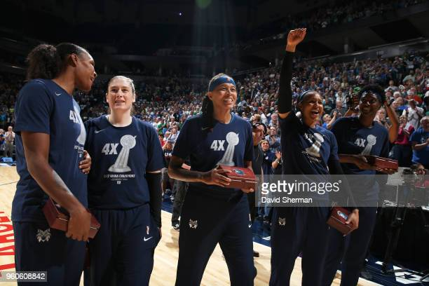 Rebekkah Brunson Lindsay Whalen Seimone Augustus Maya Moore and Sylvia Fowles are photograhed during the ring ceremony before the game against the...