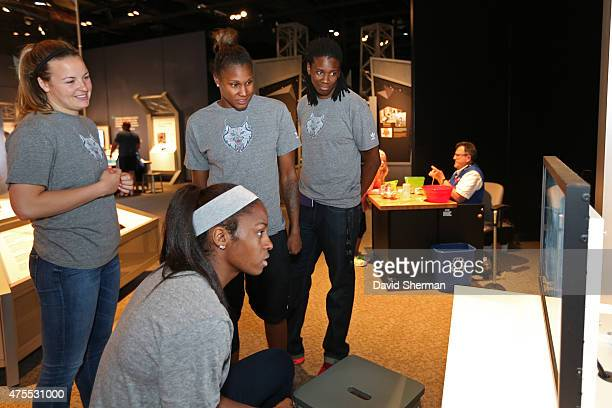 Rebekkah Brunson Monica Wright Devereaux Peters Tricia Liston and Amber Harris of the Minnesota Lynx visit the Science Museum of Minnesota with...