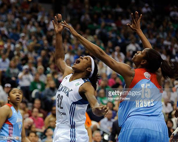 Rebekkah Brunson of the Minnesota Lynx and Tiffany Hayes of the Atlanta Dream watch a basket shot by Brunson during Game Two of the 2013 WNBA Finals...