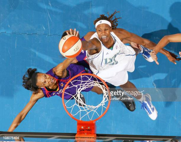 Rebekkah Brunson of the Minnesota Lynx battles for the rebound against DeWanna Bonner of the Phoenix Mercury during the game on July 24 2010 at the...